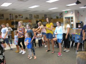 SRIS students dancing with pre-schoolers